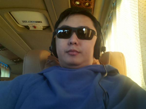 Jeffery Lam inside Aeroline listening songs
